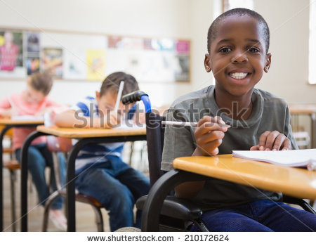 stock-photo-disabled-pupil-smiling-at-camera-in-classroom-at-the-elementary-school-210172624